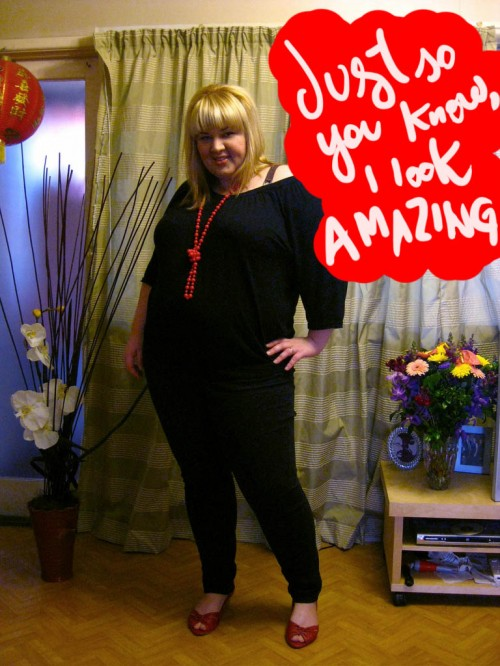 "Photo of a blonde me wearing black skinny jeans and a baggy black top and a photoshopped speech bubble saying ""Just so you know I look amazing""."