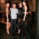 Full length shot of three models in George Wu designs and the designer standing with them.