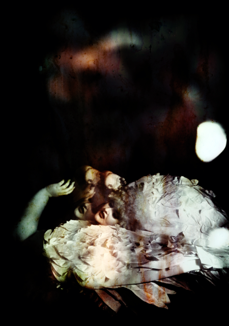 A photo of a pale skilled plus size model in a big pale wig lying at the bottom of the frame, the picture is fragmented a little.