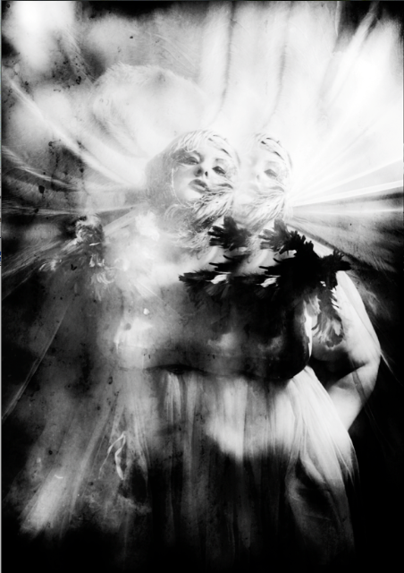 A black and white fragmented photo of a pale skinned plus size model looking very Virgin Mary with a large white aura of feathers (I think!) around her head.