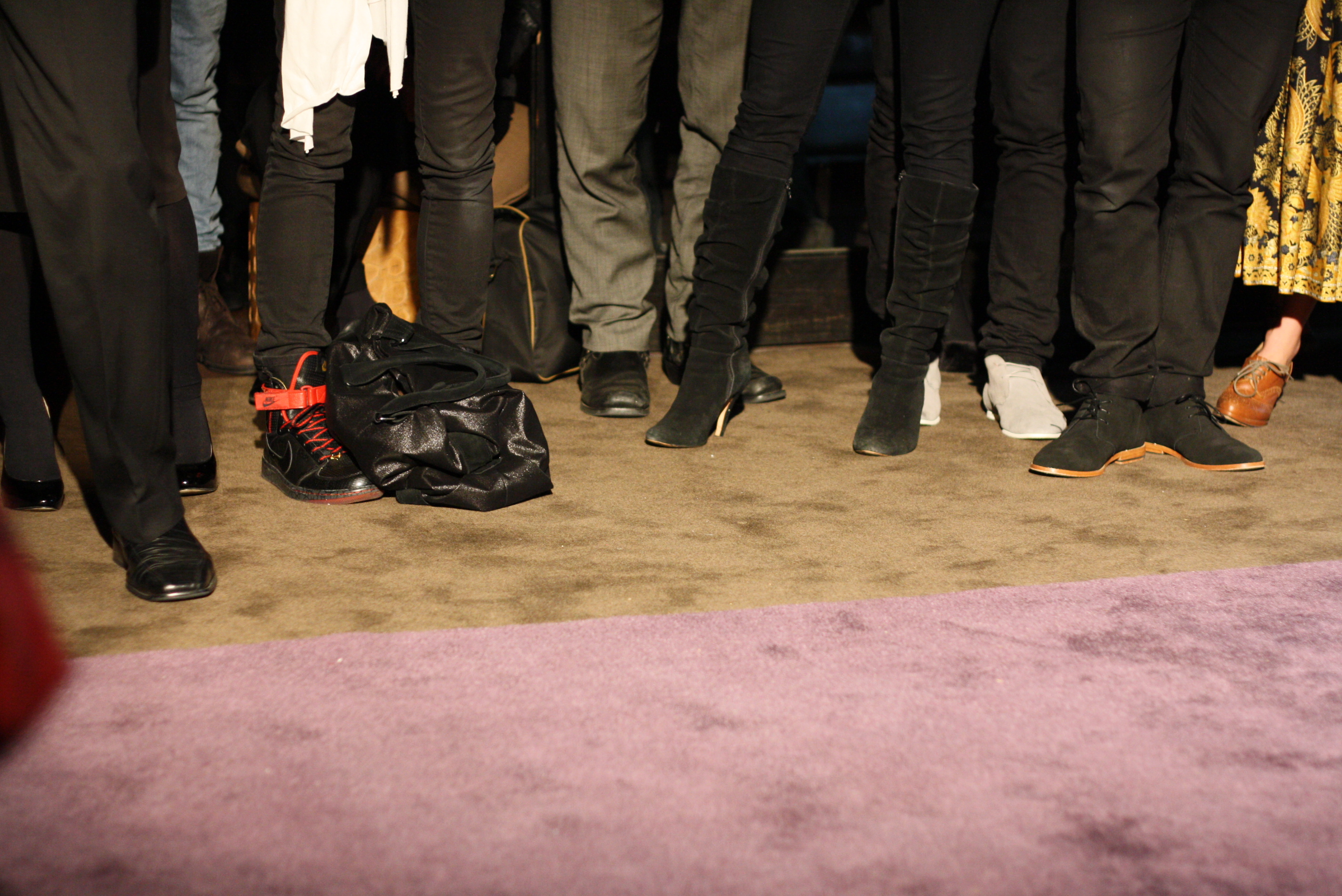 Shot of shoes of audience members.
