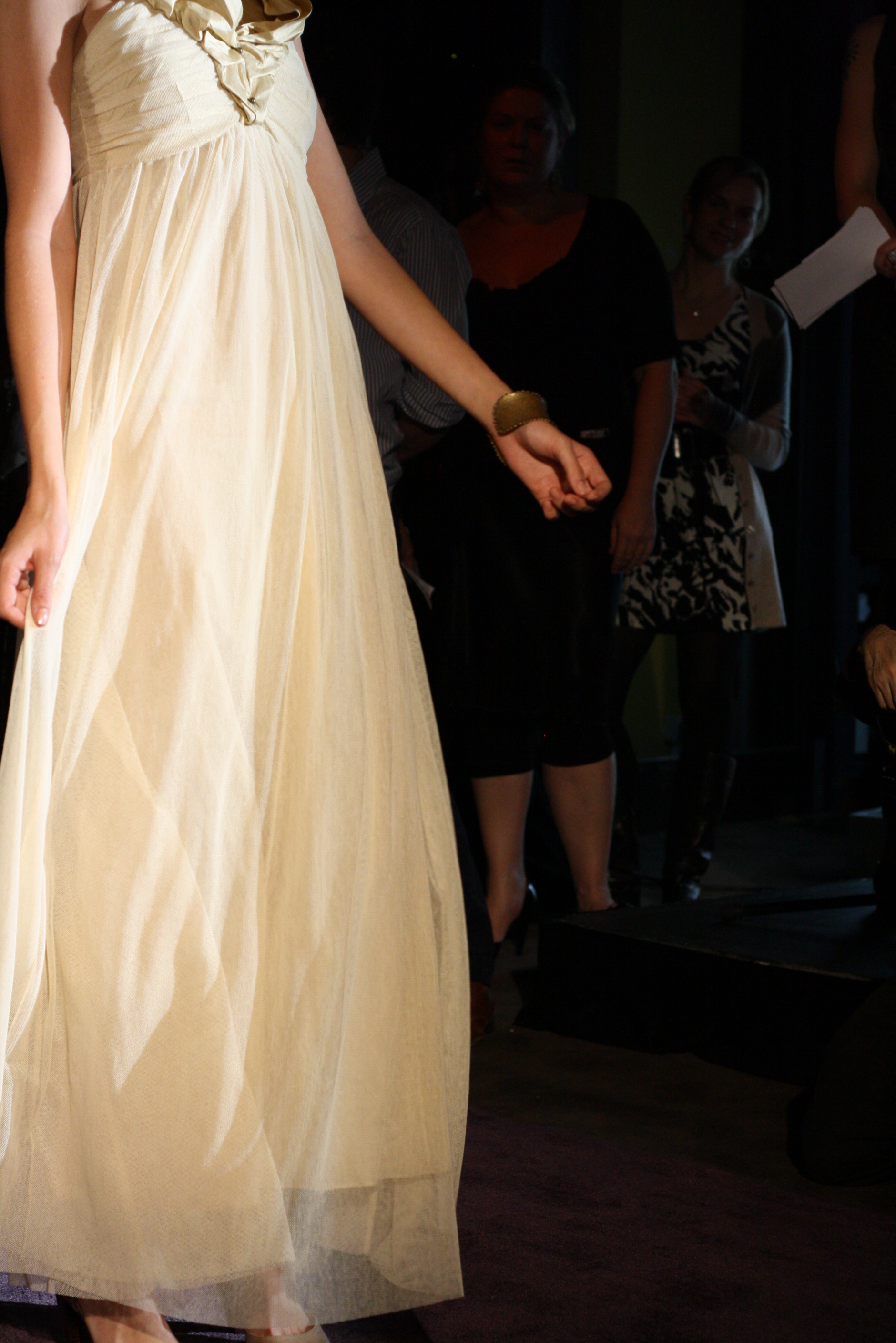 Detail of model's skirt - long white and flowing.