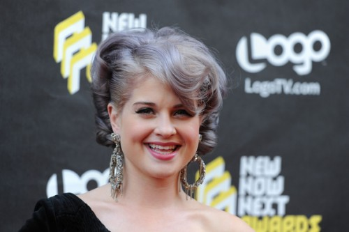 Photo of a young pale skinned young woman with platinum/ purple toned hair.