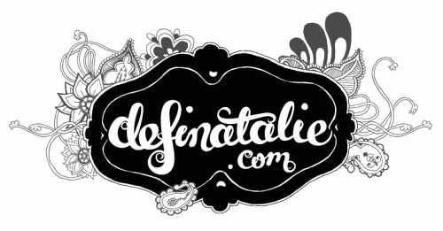 I've drawn a banner for my blog in black and grey, with a large badge saying 'definatalie.com' and paisley behind it.
