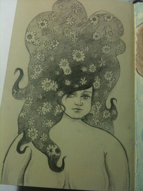 Pencil illustration in sketchbook of a chubby girl with big hair with flowers in it.