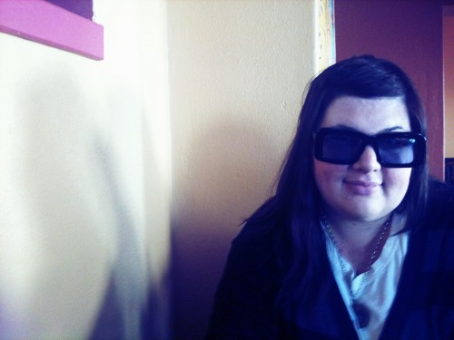 Photo of me wearing the big squarish Karen Walker sunglasses.