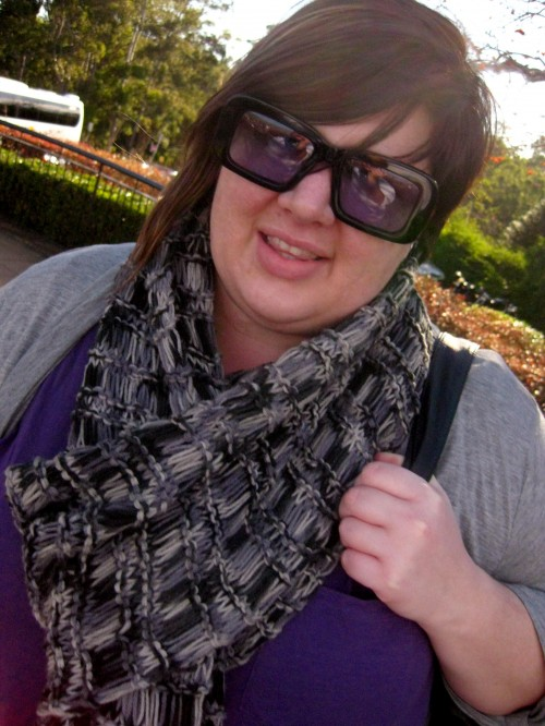 An awkward close up shot of me. My sunglasses have purple lenses and they match my tshirt!