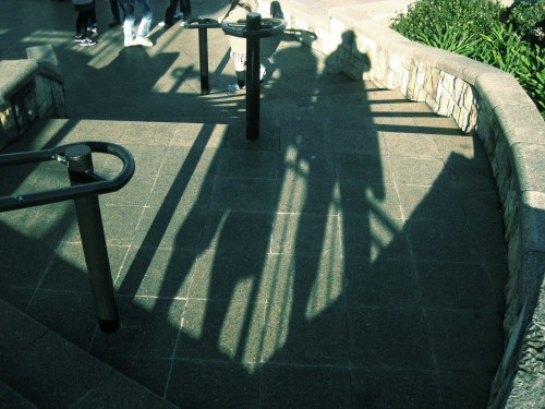Photo of the long stretched afternoon shadows of Nick and I.
