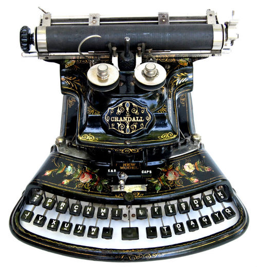 A beautiful and ornately decorated Crandall typewriter, it has a wonderful curved and ornate Victorian design and is lavishly decorated with hand painted roses, accented with inlaid mother-of-pearl!