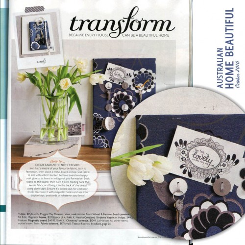 "Scan of Home Beautiful magazine: Heading says ""transform"" and shows a vase of flowers next to a blue fabic covered noticeboard. An inset photo shows detail of the noticeboard, and my postcard is attached to it. The postcard says ""You look as lovely as the day we met."""