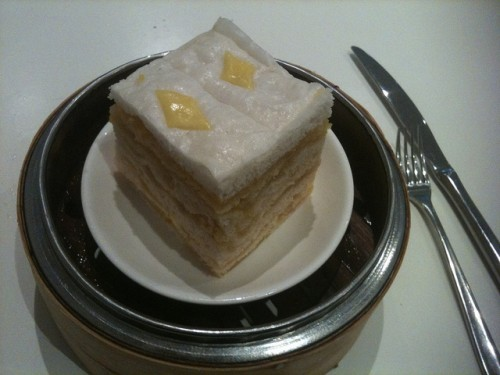 Photo of a cake with lots of layers in a steaming basket.