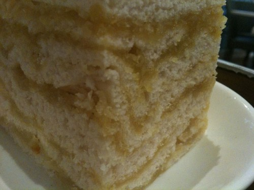 Macro shot of the thousand layer cake - lots of cake layers with yellow wintermelon in between.