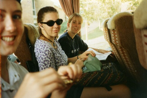 Photo of me and teenage school friends on a bus. I'm listening to a walkman and have sunglasses on.