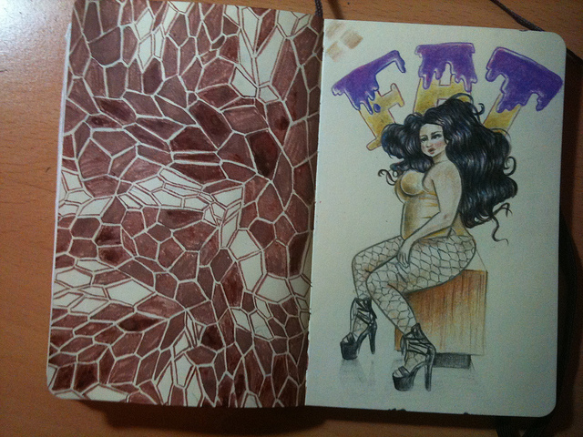 "Photo of two pages in a moleskine, left has a crystal-fragment like pattern painted in burnt sienna ink; the right page has a pencil drawing of a fat woman wearing a gold leotard, fishnet stockings and shiny black high heels with the word ""FAT"" written behind her, the letters dripping with purple icing."