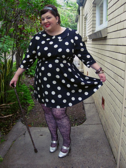 Outfit photo of me in the polka dot dress - I'm holding the hem of the skirt out.