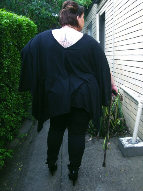 Photo of the back of the outfit with the oversized black top and skinny jeans - the back neckline actually comes into a V! It reveals a little of the tattoo on my upper back, a fairy falling through bubbles.