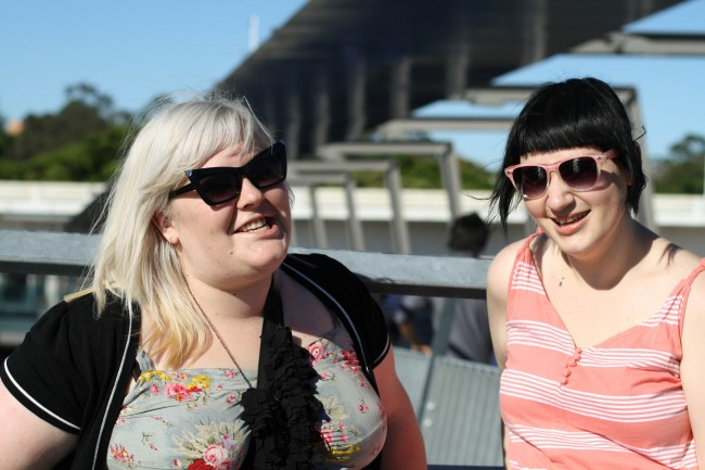 Photo of Zoe and Sonya on the bridge, laughing.