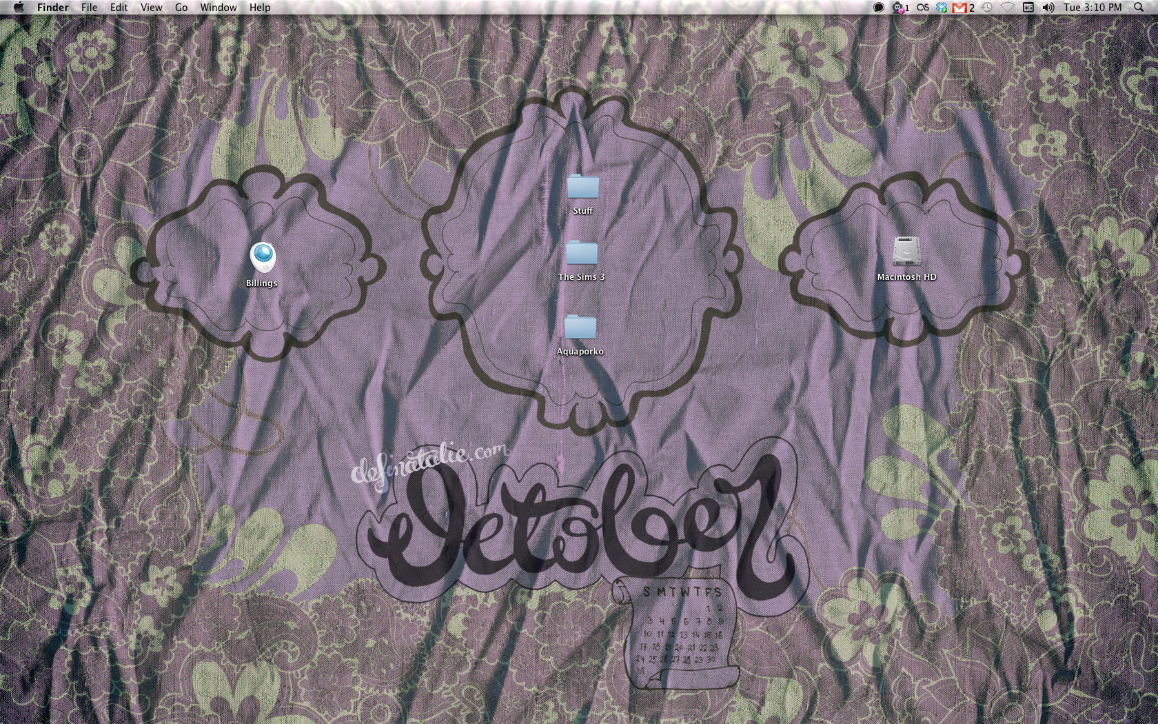 The preview of my desktop for October in action - Purple scrunched up silk with pale green paisley doodling around the borders and October written in chunky script.