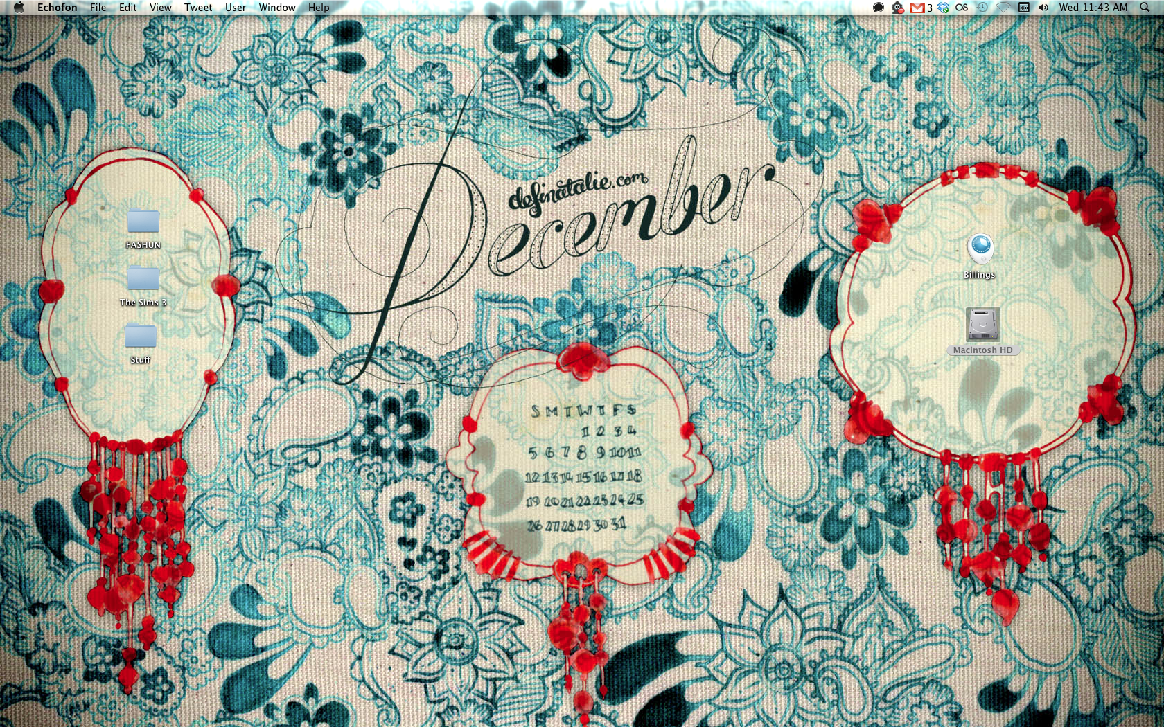 "A computer wallpaper with paisley doodling all over the background in turquoise ink with three choral inked shapes (for holding icons) and a fancy ""December"" written in the middle."