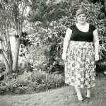 Black and white and slightly blurry photo of me in the garden.