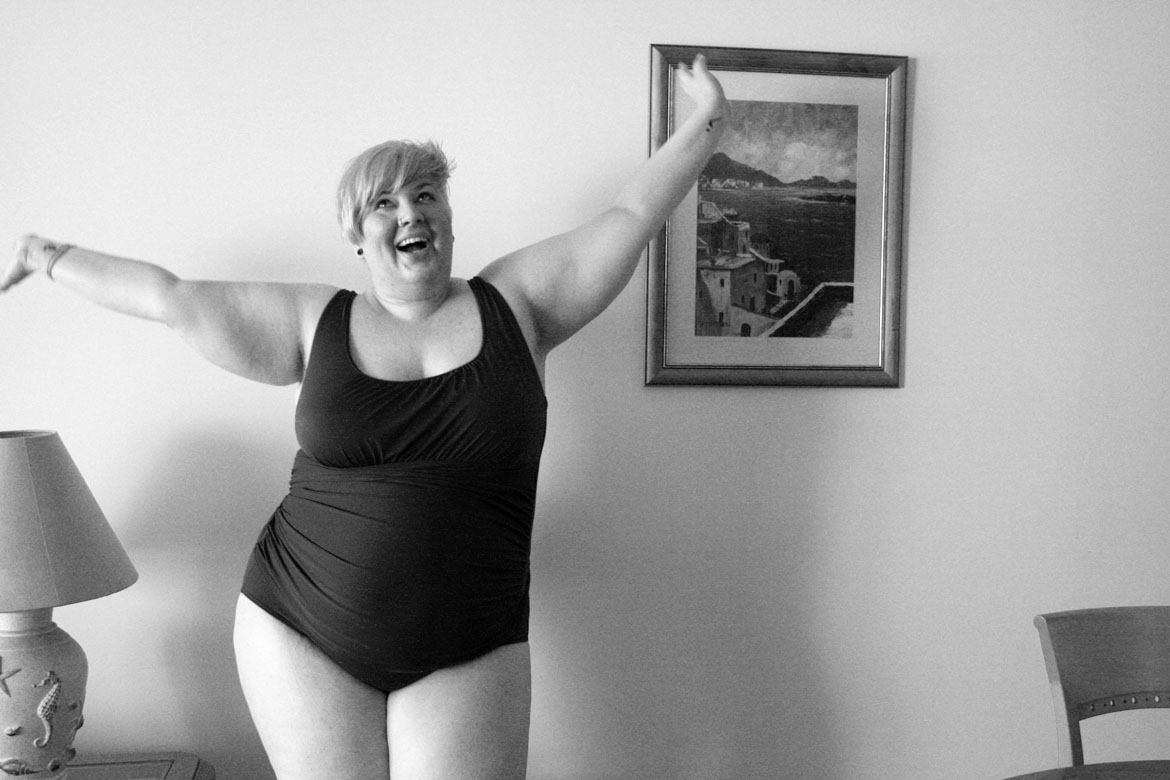 Black and white photo of me wearing a swim suit throwing my arms in the air.