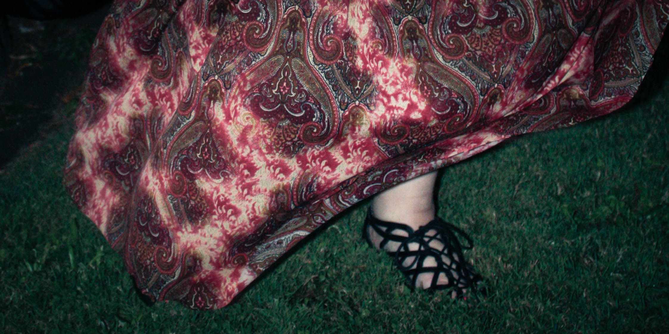 A photo of my red maxi skirt billowing out around my legs.