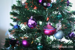 Purple, pink, blue baubles on the tree (including tiny mirrored disco balls!)