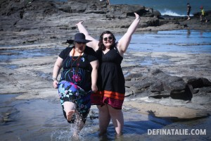 Erin and I standing in the rock pools, I'm kicking water and Erin has her arms outstretched.