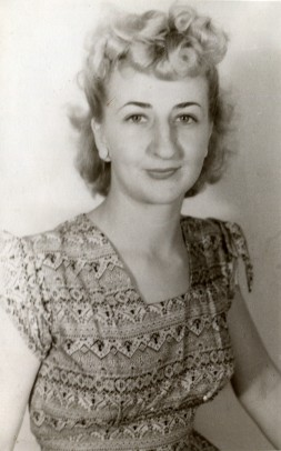 Nana in 1946 at 20, wearing a cute square neck dress and a curled fringe.
