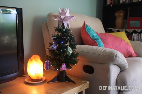 Our tiny giftmas tree with papercraft gems and rock salt lamp.