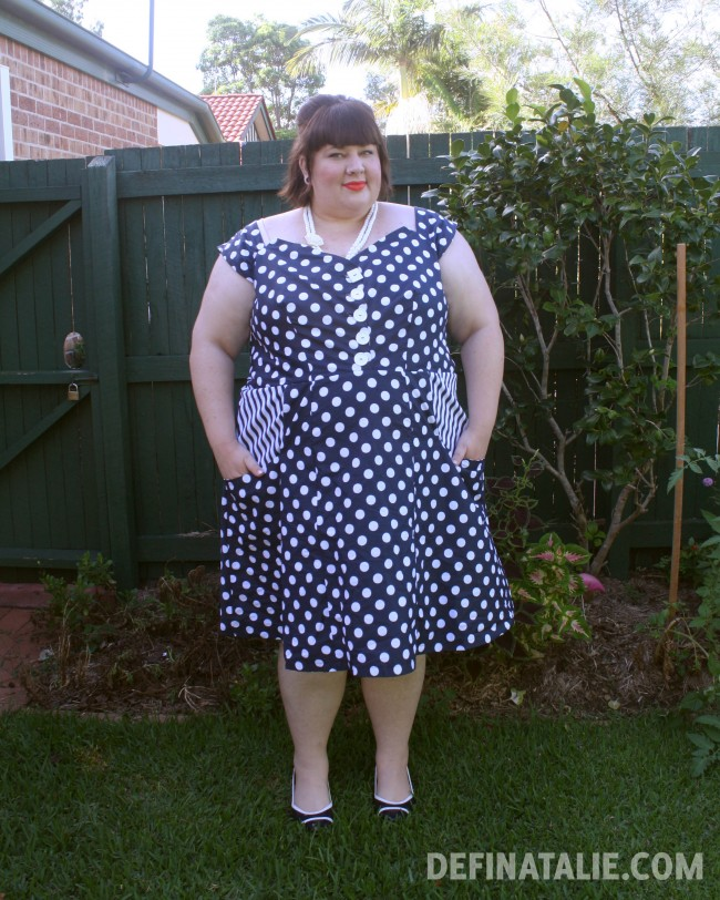 Modelling my new handmade dress in navy polka dots with striped pocket lining at the hips.