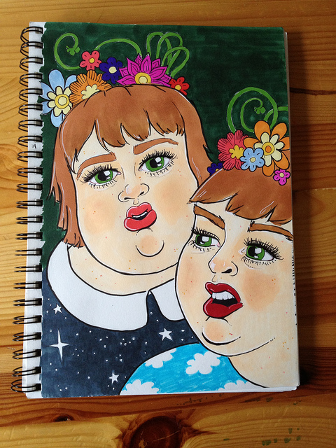 Marker drawing of two self portraits, both looking confused and in mid conversation.