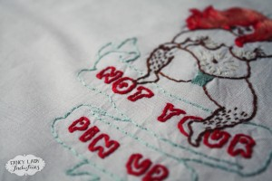 Detail of my finished version of the Not Your Pin Up embroidery pattern.