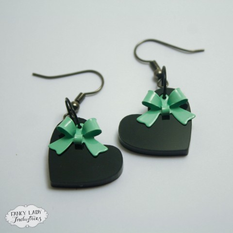 Sweet Heart earrings - Black acrylic hearts with mint bow charms dangle from hook earrings. Also available in frosted purple and assorted colour bows.