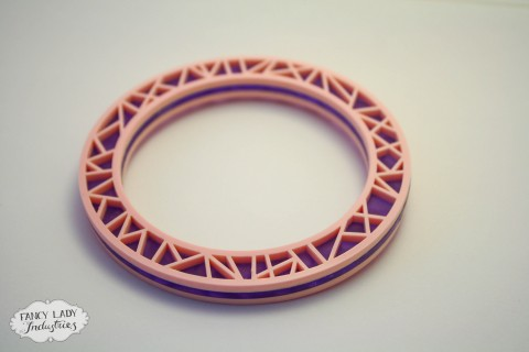 Gem Powa bangle - frosted purple sandwiched between baby pink laser cut acrylic. Also available in black and gold glitter.