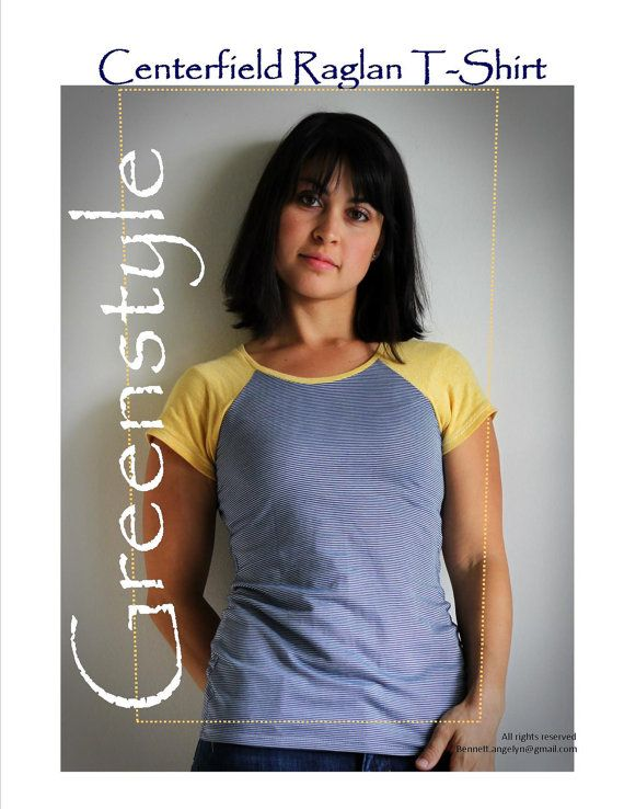 The model wears this grey raglan tee with contrasting yellow sleeves and neck binding.