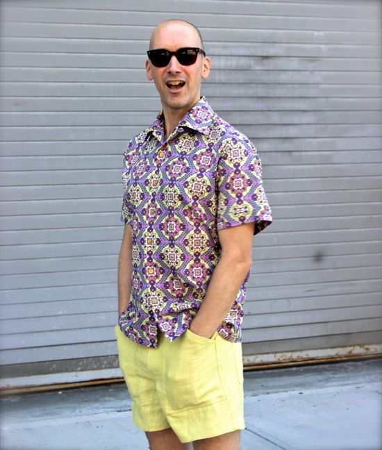 Peter Lappin of Male Pattern Boldness modelling a purple patterned short sleeve shirt.