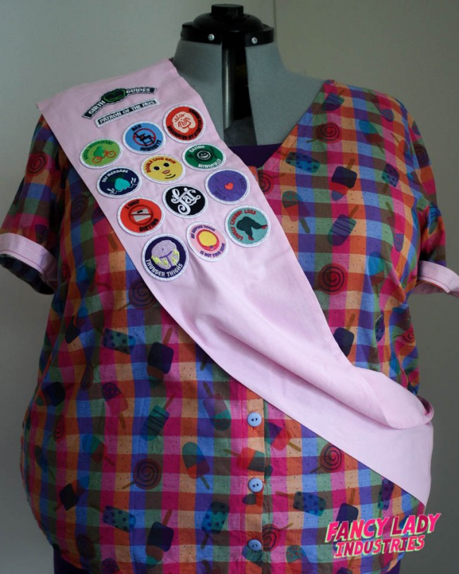My personal pink collector's sash modelled by my dress form. The whole collection of Girth Guides patches have been sewn on.