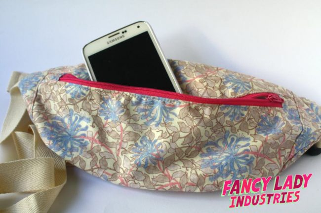 This bumbag uses a William Morris print in pastel pinks, creams and blues. I adore it! I've popped my beat up Samsung s5 in the bag to show scale. These bags will fit your phone, keys and a little purse.