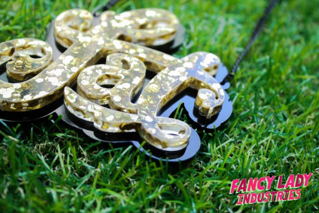 Currently out of stock, but new gold glitter fat necklaces coming soon!